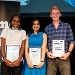The winners of the international final of FameLab 2019. UvA astronomer Athira Menon (middle) was on of the two runner-ups.